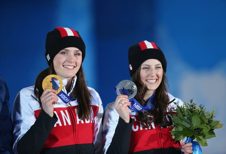 SOCHI, RUSSIA - FEBRUARY 21: (L-R) Gold medallist Marielle Thompson (Whistler, British Columbia) of Canada and silver medalist Kelsey Serwa (Kelowna, British Columbia) of Canada celebrate during the medal ceremony for the Women's Ski Cross on day fourteen of the Sochi 2014 Winter Olympics at Medals Plaza on February 21, 2014 in Sochi, Russia. (Photo by Quinn Rooney/Getty Images)