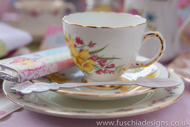 Vintage teacup to hire. Table talk trivia spoons make great additions to a vintage wedding or celebration. www.fuschiadesigns.co.uk