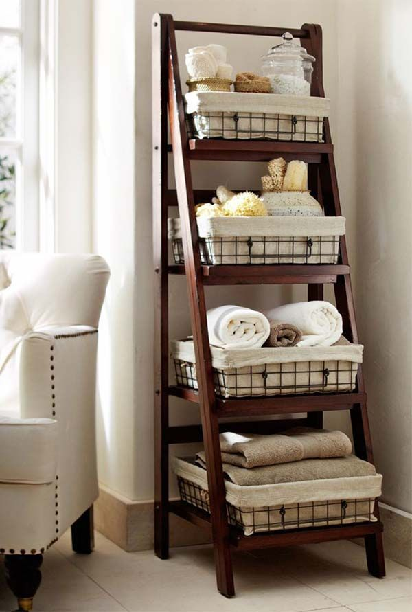 bathroom shelf ideas. Cute little ladder with baskets and toiletry storage.
