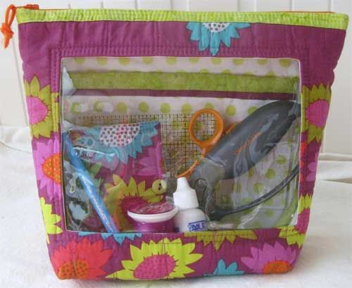 This bag is perfect for storing and organizing your notions, tools and sewing projects.