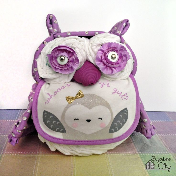 Tutorial for making the cutest owl diaper cake! This owl diaper cake makes a great gift for any expecting mother and a perfect baby shower surprise!
