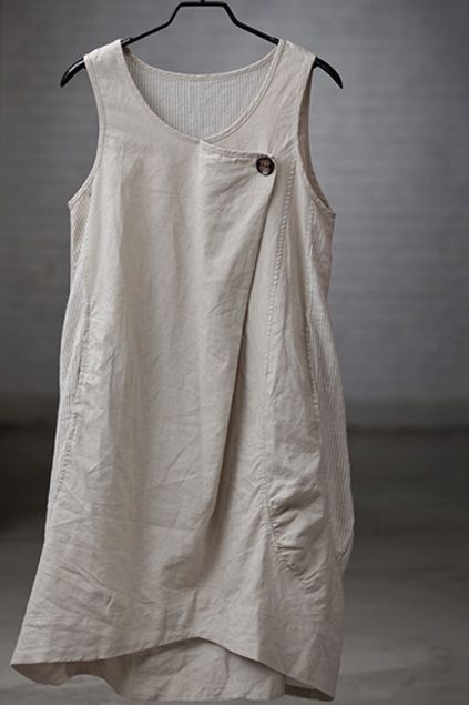 asymmetrical sleeveless dress - linen fabric, pleated back for fullness, contrast sides, pockets, front flap/button