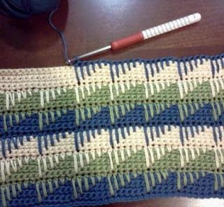 A very interesting use of the Spike Stitch.  No link to a pattern, but the photo is clear enough to see how it is done.  My guess is 6 stitch repeat,  3 rows of SC. On the next row,  start with 1 HDC, then do gradually longer spikes, first  the stitch, next one below the stitch, etc., moving down each row.  The pinner said HDC spikes were used. For the diamond effect, the next 3 rows of SC are the same color as the spike stitches below.  Can't wait to try this.