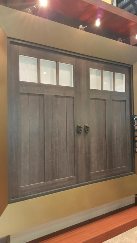 Clopay Canyon Ridge Collection faux wood carriage house garage door with a custom gray stain finish & 14 best Clopay Doors at the 2017 International Buildersu0027 Show images ...