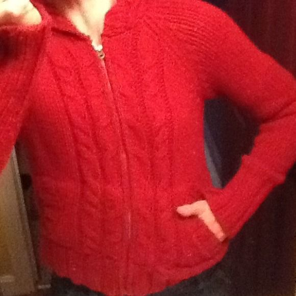 """Women's Red Abercrombie & Fitch Zip up Sweater Women's Candy Apple Red Zip up sweater w/hood & pockets. Acrylic/Wool. Mild sweater balls,no stains/ rips. Very comfy & warm for cool fall weather days ahead.Tag says Large, but it's shrunk some, fits more medium, 28 """" sleeve About 20"""" length. Can bundle with other A & F sweaters! Abercrombie & Fitch Sweaters"""
