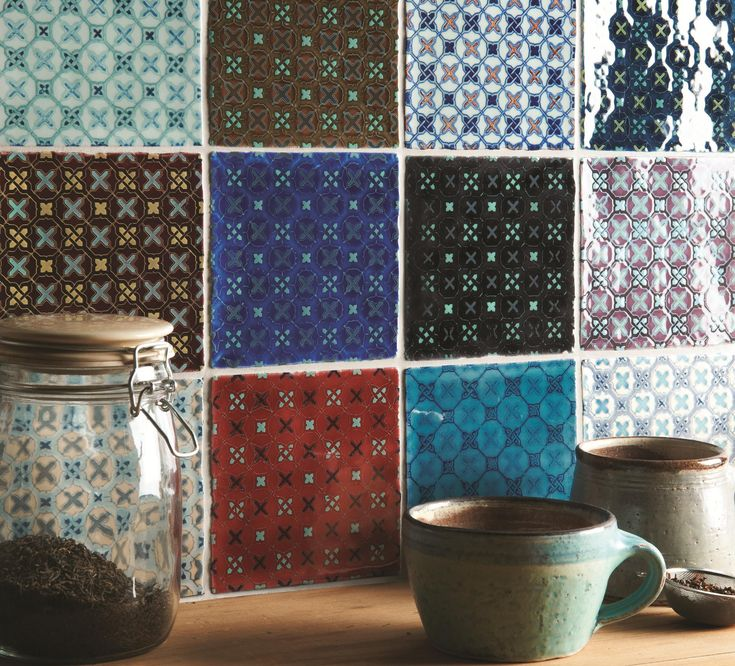 The Ormeaux pattern is shown on a patchwork selection of colours. Mix and match these tiles for maximum impact. Handmade ceramic tiles from the Chateaux collection by The Winchester Tile Company. winchestertiles.com