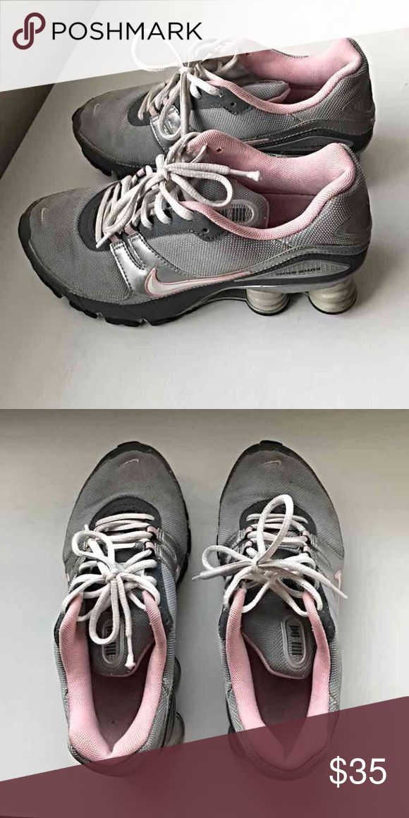 Nike shocks size 7 Nike shocks in grey and pink. Previously owned but still in good condition. Women's Size 7 Nike Shoes Athletic Shoes
