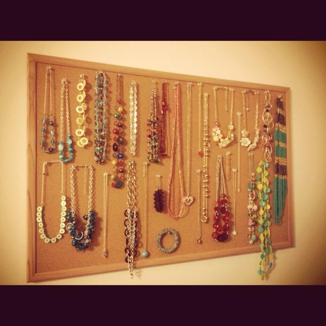 Bulletin board + clear push pins = homemade jewelry organizer