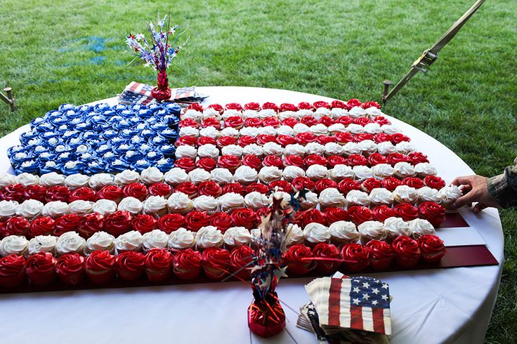 Cupcakes in American flag pattern... flag underneath, so when the cupcakes are taken away, the flag pattern is still there.