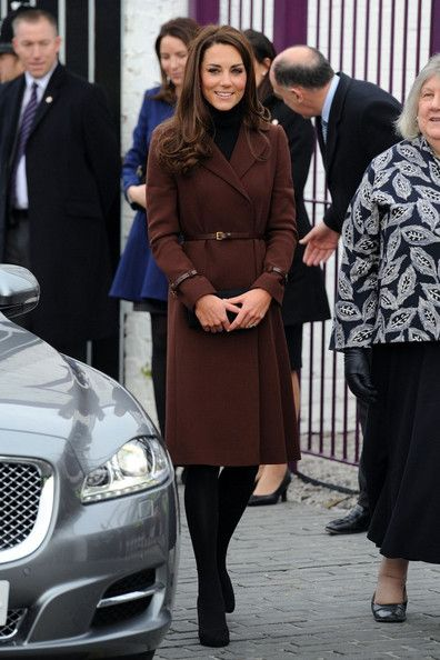Kate Middleton Wool Coat Kate Middleton looked demure as ever in a burgundy wool coat with a thin leather belt. Brand: Hobbs