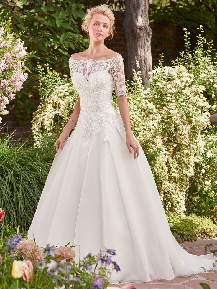 Rebecca Ingram - DARLENE, This classic tulle over Chic organza ballgown features a sweetheart neckline and a lovely lace bodice. Finished with corset closure, or covered buttons over zipper and inner elastic closure. Off-the-shoulder lace jacket with elbow-length sleeves sold separately.