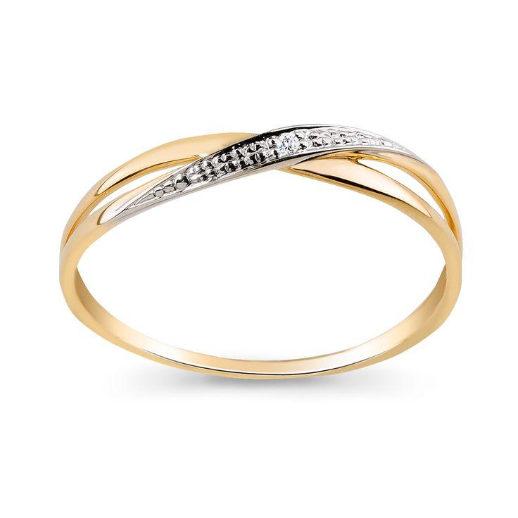 Oryginalne i nowoczesne wzornictwo zyskało na popularności w jubilerskim fachu. Nie zapominając jednak o elementarnych zasadach rzemiosła zaprojektowano ten elegancki i pełen wdzięku pierścionek, w którym dwukolorowe złoto połączono z diamentem i ciekawie rozgałęziającą się powierzchnią.