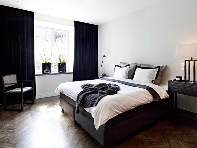 black curtains from ceiling to floor.