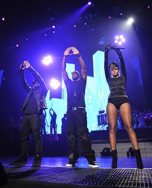 Jay-Z, Rihanna, and some random giving the Illuminati sign to the crowd.. if you give it back that pretty much means you're participating in satanic worshipping shenanigans.