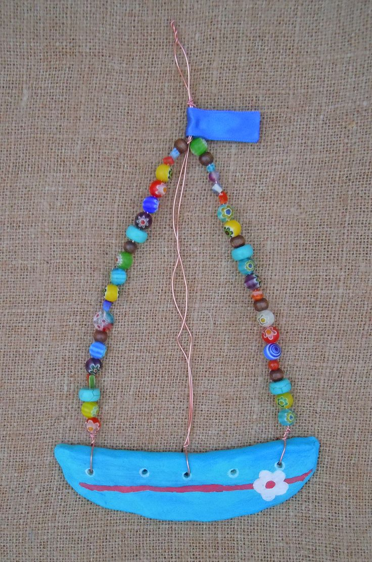 Ceramic and beads sailing boat to hang on the wall
