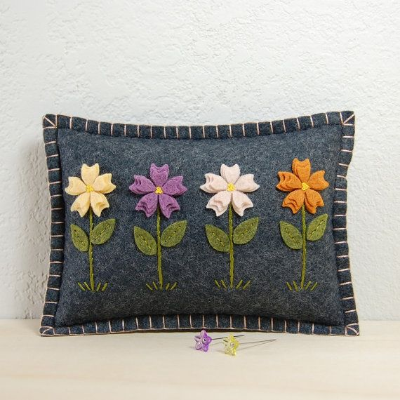 Many creative designs at this Etsy Shop.  (Flower Garden Pincushion / Small Pillow - Hand Embroidered on Grey Wool Felt)