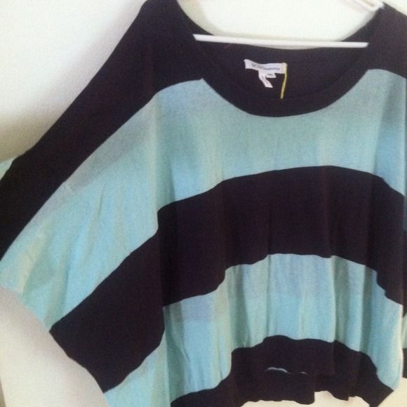 BCBGeneration Blue striped top Navy and light blue striped top.  Loose, slouchy fit.  Looks great with leggings or skinny jeans. Slight high-low look.  Great, pre owned condition. BCBG Tops