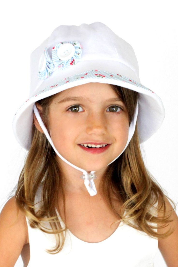 Cherry Trimmed Bucket Hat with Strap in White. Rated UPF50+ Excellent Protection. RRP $29.95 AUD.