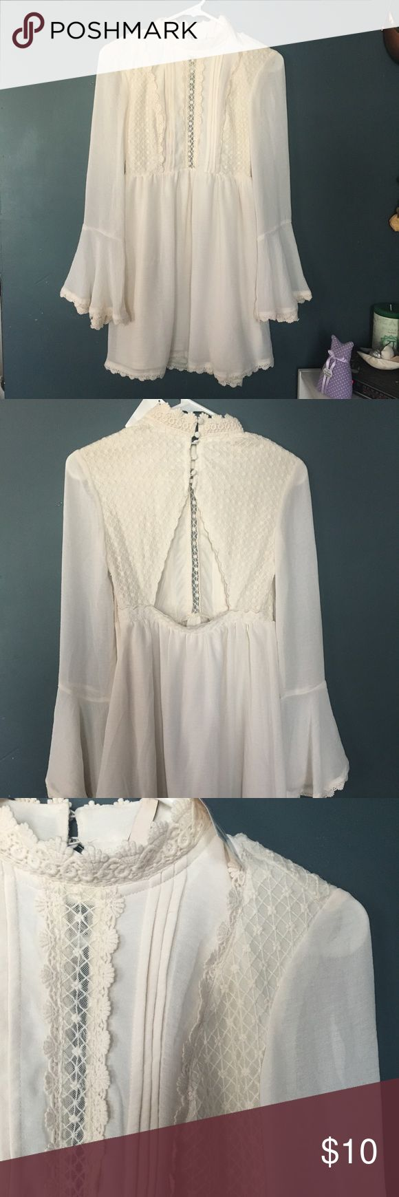 Elegant Boho Dress Brand New / never worn white dress with gorgeous detailing. Big bell sleeves with an open back. Neck is high collar that has a very victorian feel to it. Super elegant but can be dressed down! From H&M but reminds me of Free People :) H&M Dresses Long Sleeve