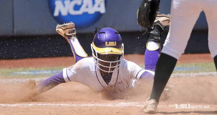 Tiger A.J. Andrews slides in home to score the only run in LSU's win over USF to stay alive in the WCWS