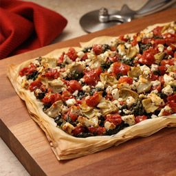Greek-Style Pizza using phyllo dough as the crust. I have made this and it's very good.