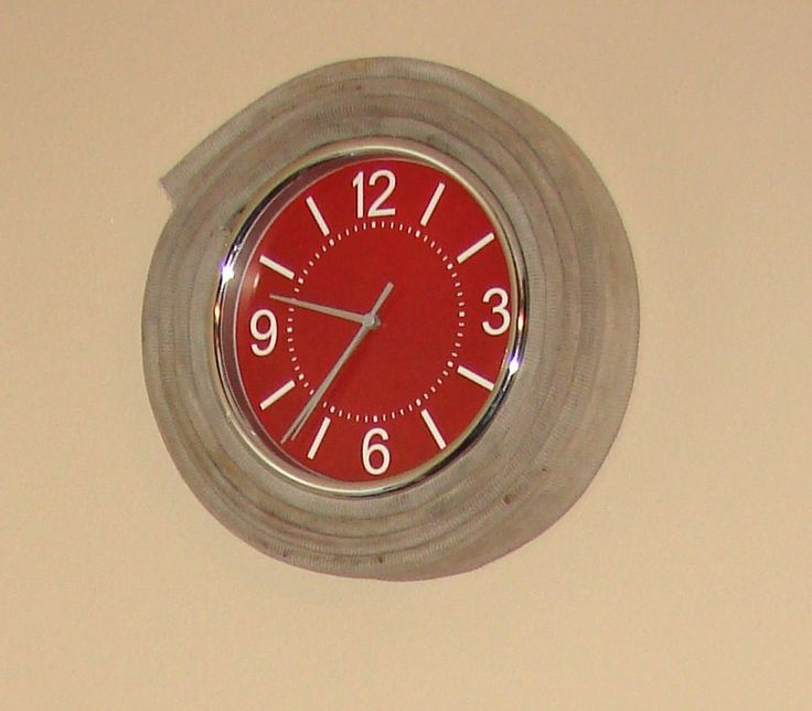 Used in Fire Truck themed nursery...cheap wal-mart clock with actual fire hose hot glued around it