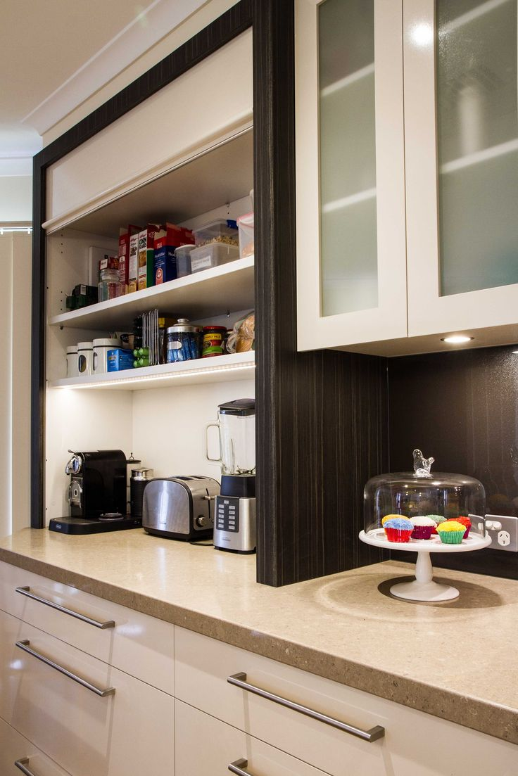 Contemporary, two-toned kitchen. Appliance pantry with sensor light. www.thekitchendesigncentre.com.au