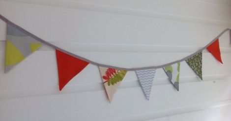 Bunting! Like a big smile for your home, bunting adds a summery, festive feel whatever the weather. Our bunting is made in New Zealand from beautiful fabrics sourced from all over the world.  Dimensions - 7 flags of 15cm (width) by 18cm (drop) on a length of 1.9m approx.