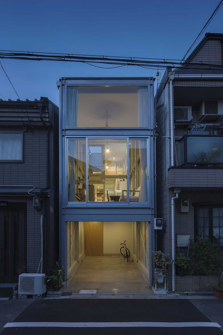 A tall structure saves horizontal space in an urban setting. - House House