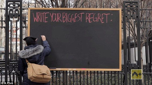 New Yorkers reveal their biggest regrets to the world by writing them on a chalkboard posted in the street