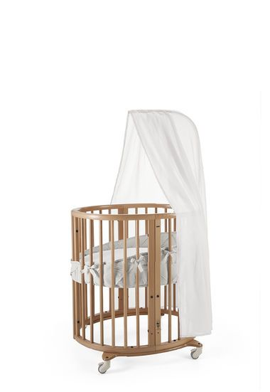 The the perfect first bed for your baby. The unique oval shape of this crib gives a nest-like environment.  Adjustable positions allow for growth. Buy online.
