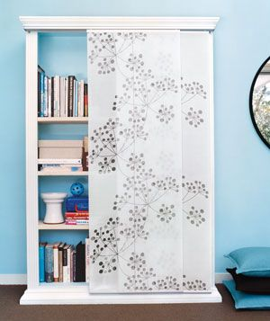 A smart cleaning strategy for drop-in visitors: panels that prettily disguise what's on the shelves.