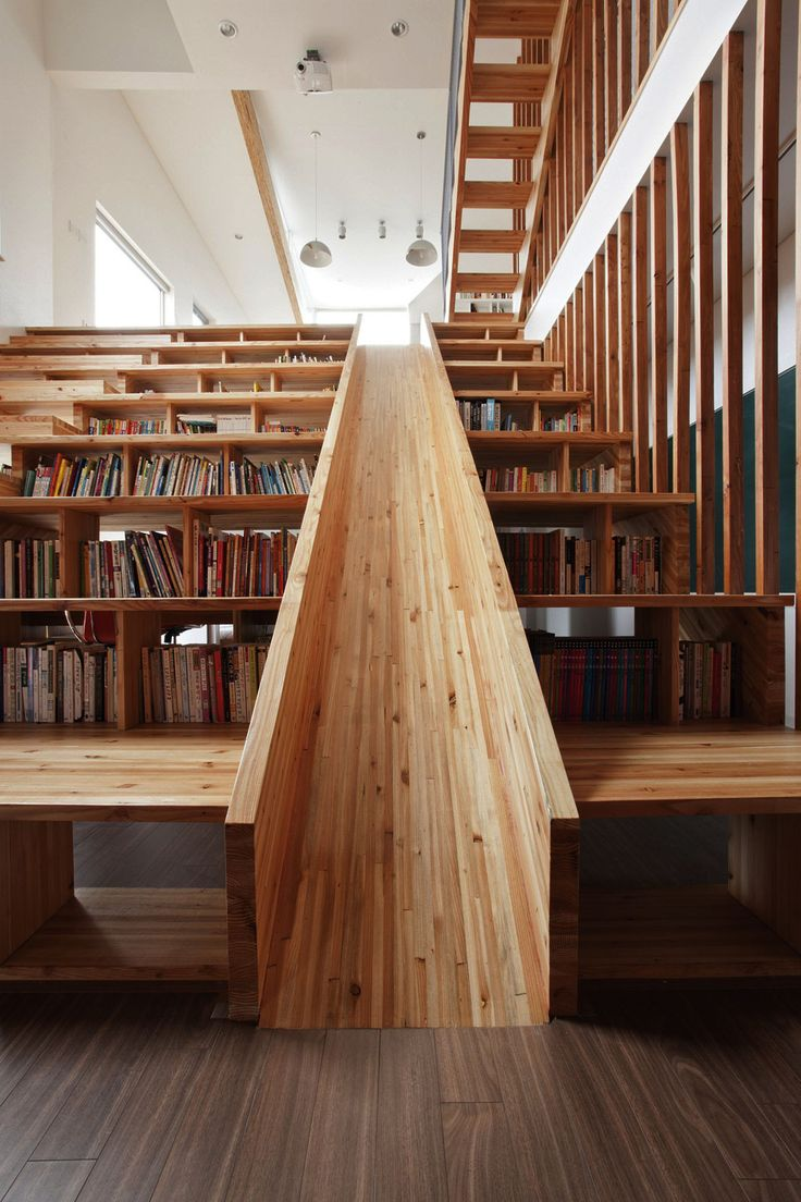 A Library Slide We love this wooden slide that is slotted into a combined staircase and bookshelf of a house in Chungcheongbuk-do, South Korea, Designed by Moon Hoon.