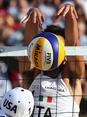 Todd Rogers, left, of US is blocked by Daniele Lupo, right, from Italy in Beach Volleyball match