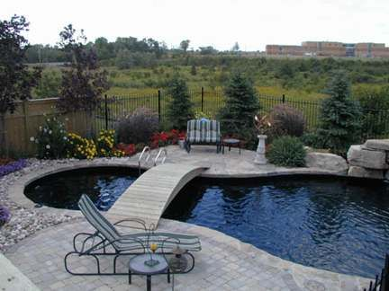 Backyard With Pool Bridge And Flower Garden Beds