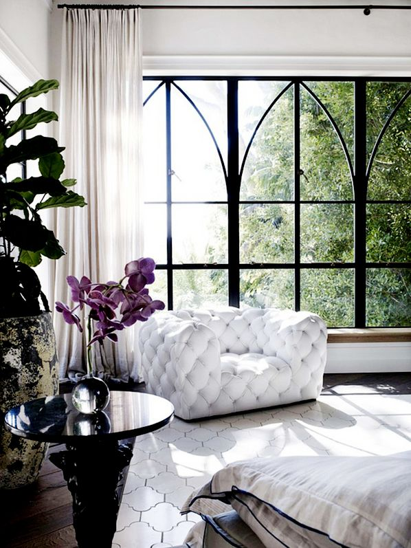 Sitting area complete with cathedral inspired windows. Old details and modern updates. Australia.