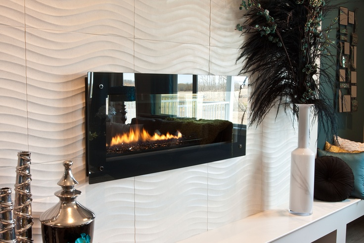 Large format tiles with lots of texture can make a feature wall special - here, our Designer Angela and Colbray homes have used 24 inch tile from Ceratec's Monet collection to acheive a completely unique look behind the fireplace.