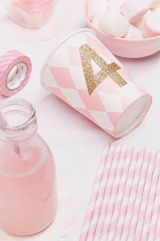 Decorate party cups with glitter tape.