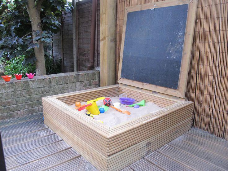 Sandpit with chalkboard