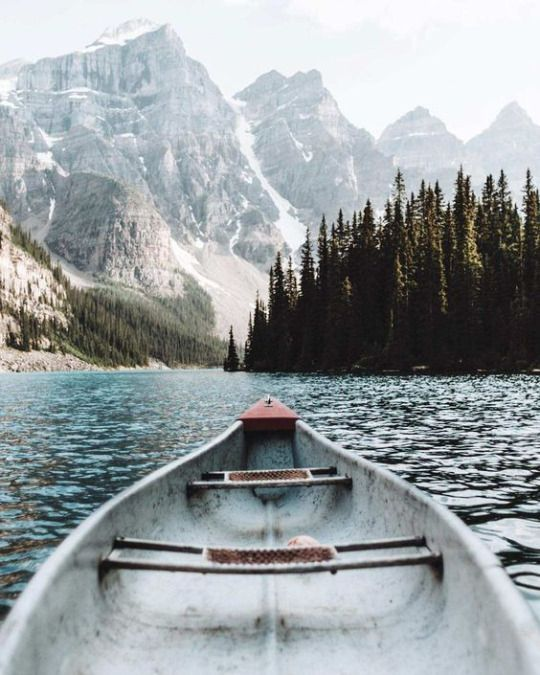 Canoe on lake in the mountains