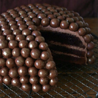 A Milk Dud cake?! This needs to be in my life immediately.  (I do agree )
