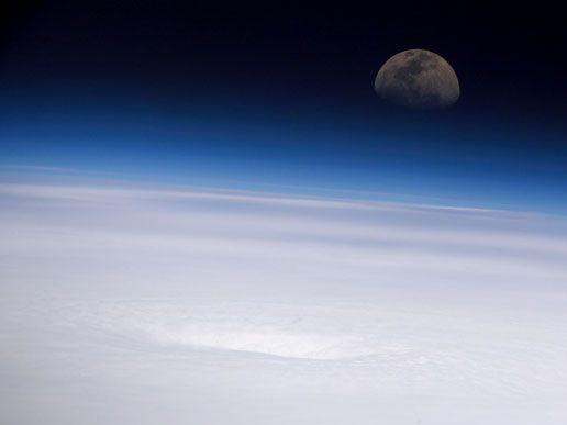 (nasa.gov - Hurricane Emily and the Moon) Panoramic view of the eye of Hurricane Emily, looking eastward toward the rising moon.