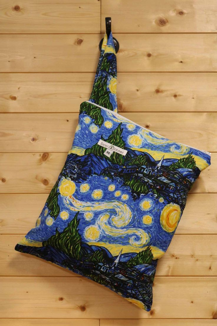 Medium Starry Night Wetbag. What is a wetbag? ~Wetbags are the busy parent's solution to easy cloth diaper storage. These bags can be hung from a hook, changing table, door nob or line a diaper pail. They are lined with high quality, American made, 2mil PUL (polyurethane laminate) for durability and lasting use. It is water resistant and will hold in the smells that are associated with dirty diapers. Wetbags are not just useful for dirty diapers. They can also be used for make up bags…