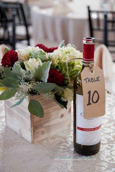 Wine bottle table number idea - kraft paper tags tied to wine bottles with twine {Jeannine Marie Photography}