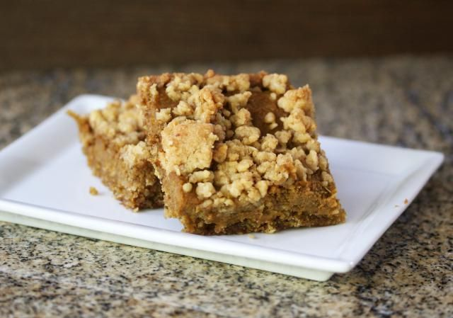 These pumpkin bars are made with an oat crust with brown sugar and crumbly topping. The pumpkin filling of these pumpkin bars is spiced with cinnamon and ginger and other spices.
