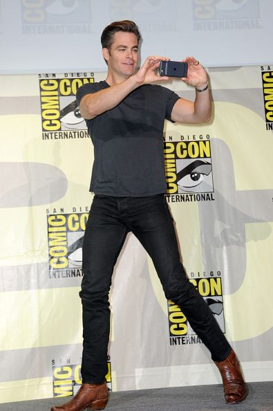 Actor Chris Pine takes a photo at the Warner Bros 'Wonder Woman' Presentation during ComicCon International 2016 at San Diego Convention Center on...