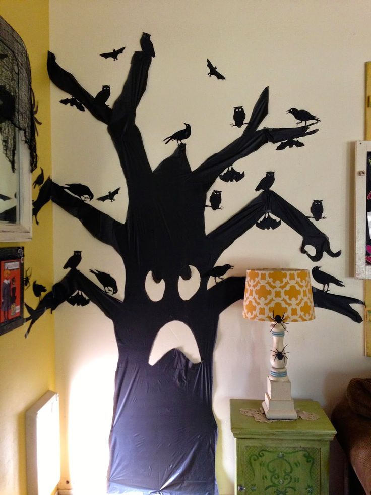 cute and easy halloween decoration for 1 made out of a black plastic tablecloth from