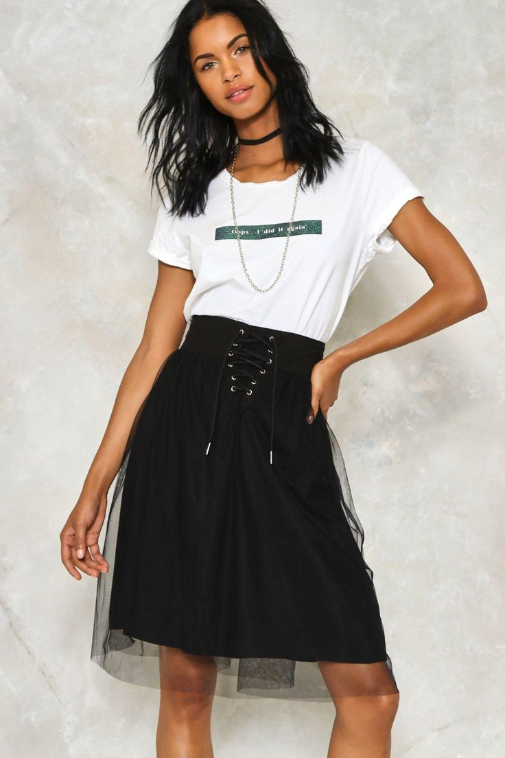 Work the tulle. This skirt features a high-waisted, midi silhouette, elastic at back waistband, tulle overlay, and lace-up detailing at front.