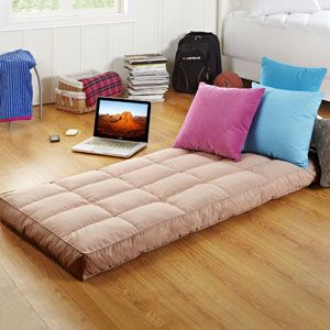 The Crash Pad® Portable Mattress $50 two of these in dif colors and some boho pillows, perfect cushion couch.