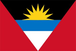 Flag of Antigua and Barbuda. The sun represents the dawning of a new era, the red indicates the energy of the people, blue is hope and the black represents its African ancestry. The V shape is said to symbolize victory and the overall combination of yellow, blue and white represents the sun, sand and sea of this Caribbean island nation.